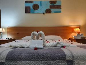 Ein Bett oder Betten in einem Zimmer der Unterkunft Residence Les Peupliers