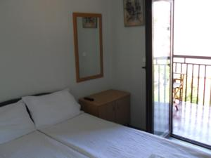 Postelja oz. postelje v sobi nastanitve Apartments Ristak