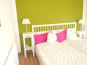 מיטה או מיטות בחדר ב-Appartement Resch