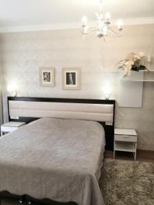 A bed or beds in a room at Апартаменты Горная карусель Красная поляна