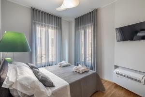 Letto o letti in una camera di 30Cavour luxury suites