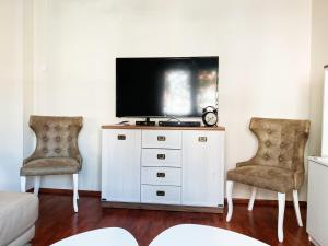 A television and/or entertainment center at Luxury apartment Podgorica