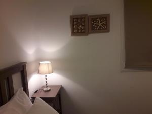 Ένα ή περισσότερα κρεβάτια σε δωμάτιο στο Heliotropio Studios & Apartments