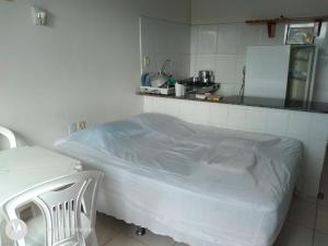 A bed or beds in a room at Residencial Dom Fernando