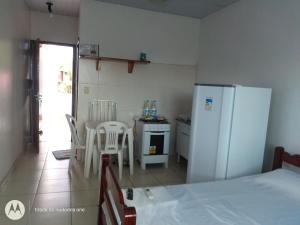 A kitchen or kitchenette at Residencial Dom Fernando