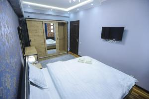 A bed or beds in a room at Guest House in Downtown, Center 5