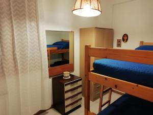 A bunk bed or bunk beds in a room at A Due Passi Dal Mare