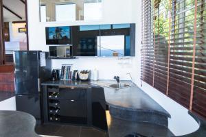 A kitchen or kitchenette at Horizon Luxury Pool Villas Koh Tao