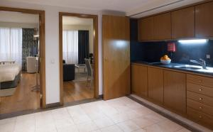 A kitchen or kitchenette at Altis Suites