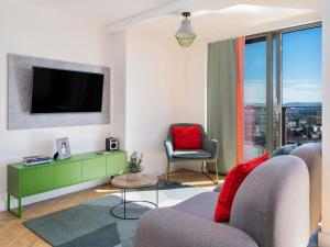 A television and/or entertainment centre at Church Street by Supercity Aparthotels
