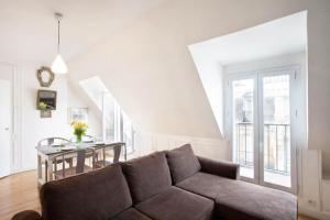 Ein Sitzbereich in der Unterkunft Paris Panoramic Views