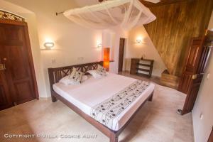 Ein Bett oder Betten in einem Zimmer der Unterkunft Villa Cookie Aunt