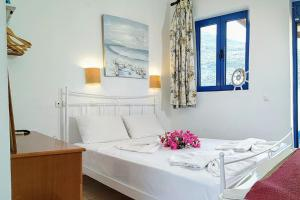 A bed or beds in a room at Lindos Athena