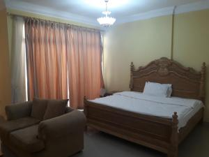 A bed or beds in a room at Reem Suites