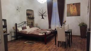 A bed or beds in a room at Apartment Jakubská 676
