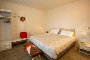 A bed or beds in a room at Podere Castagne
