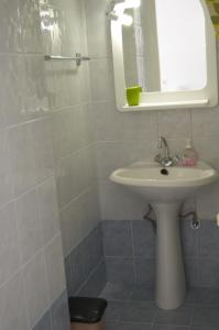 A bathroom at Odyssia Apartments