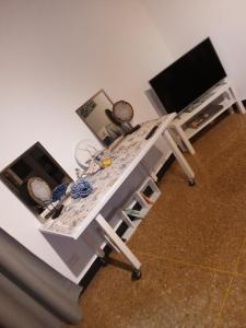 A television and/or entertainment center at Acquario Inn Genova House