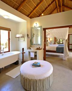 A bed or beds in a room at Azura Benguerra Island, Mozambique