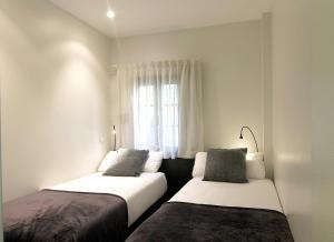 A bed or beds in a room at Classbedroom Born Apartments