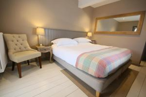 A bed or beds in a room at The Apartments @ Quidhampton Mill