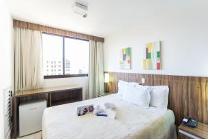 A bed or beds in a room at Nobile Suítes Hotel Asa Norte - Apartamento Particular