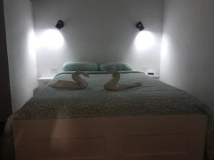 Ein Bett oder Betten in einem Zimmer der Unterkunft Apartamento Playa Chica Tenerife