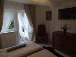 Ein Bett oder Betten in einem Zimmer der Unterkunft NiJole Apartment