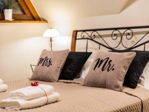 Łóżko lub łóżka w pokoju w obiekcie Apartament Zacisze pod Giewontem