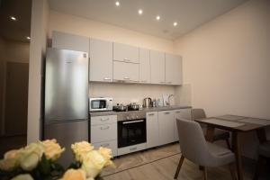 Кухня или мини-кухня в Апарт-отель АНИС МонАрх Хорошевский