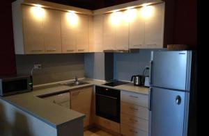 A kitchen or kitchenette at Kevin's Apartments - Sozopol