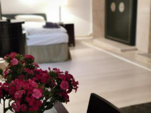 A bed or beds in a room at Wellness Appartement