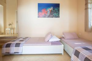 A bed or beds in a room at Ionian View Villas