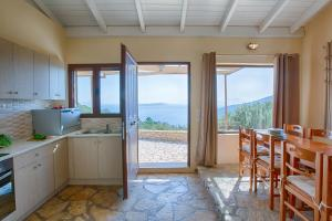 A kitchen or kitchenette at Ionian View Villas