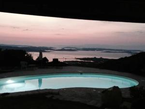 The swimming pool at or near Villa Monte Moro ''Azzi Russi''