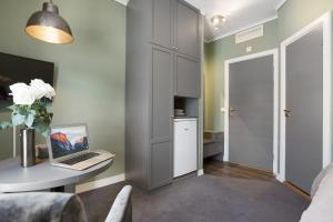 A television and/or entertainment center at Forenom Serviced Apartments Oslo Airport