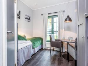A bed or beds in a room at Forenom Serviced Apartments Oslo Airport