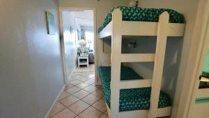 A bunk bed or bunk beds in a room at Emerald Skye 32