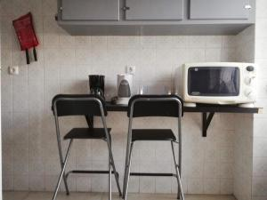 A cozinha ou kitchenette de TripGeo Apartment Roma
