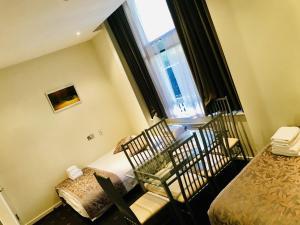 Ein Bett oder Betten in einem Zimmer der Unterkunft Grand Plaza Serviced Apartments