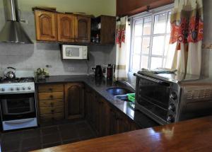 Una cocina o kitchenette en La Amorosa