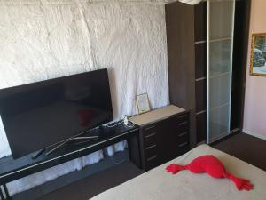 A television and/or entertainment centre at Apartment with Terrace