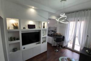 A television and/or entertainment center at casa ottaviano IGIENE 10