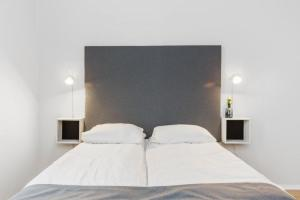 A bed or beds in a room at Forenom Serviced Apartments Oslo Vika
