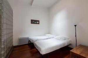 A bed or beds in a room at Veeve - Central Escape by the Seine