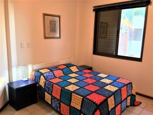Cama o camas de una habitación en Apartamento Ponta das Canas Frente do Mar