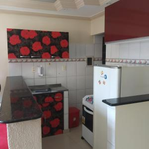 A kitchen or kitchenette at Cantinho de Itapuã
