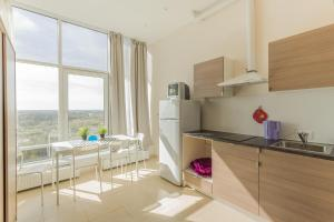 Кухня или мини-кухня в Penthouse-apartment TwoPillows Petergofskoe shosse