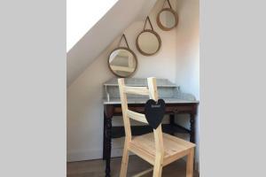 Ein Etagenbett oder Etagenbetten in einem Zimmer der Unterkunft L'Alsacien