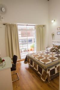 A bed or beds in a room at Studios Jovita House